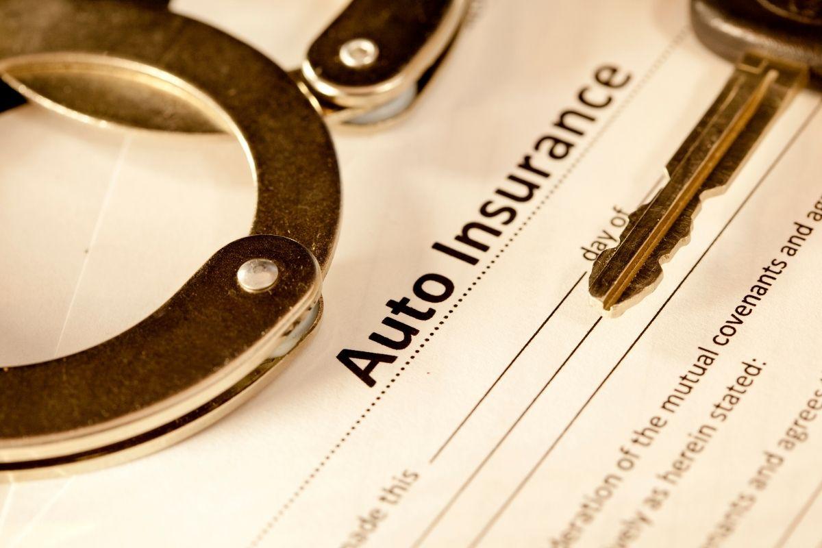 auto insurance fraud handcuffs car key